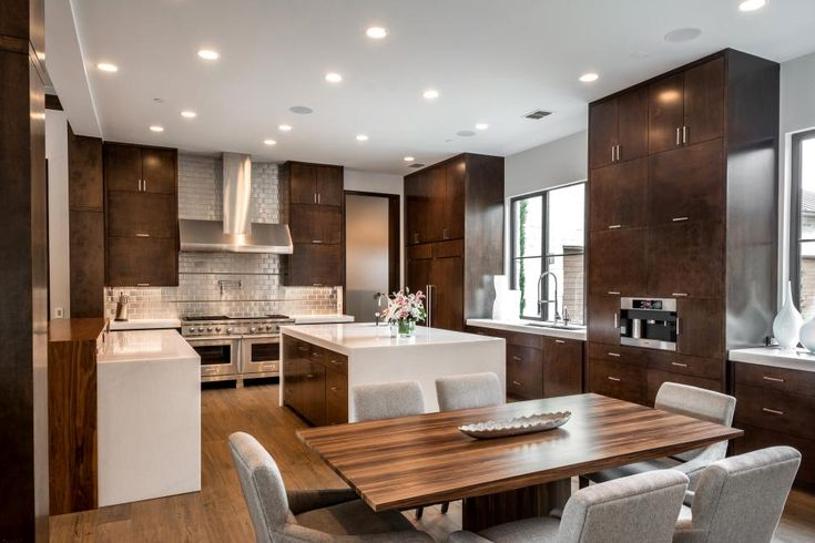 This Dallas home with interiors custom designed by Carrie Maniaci blends elements from the homeowners' love of outdoors and career rooted in the steel industry.