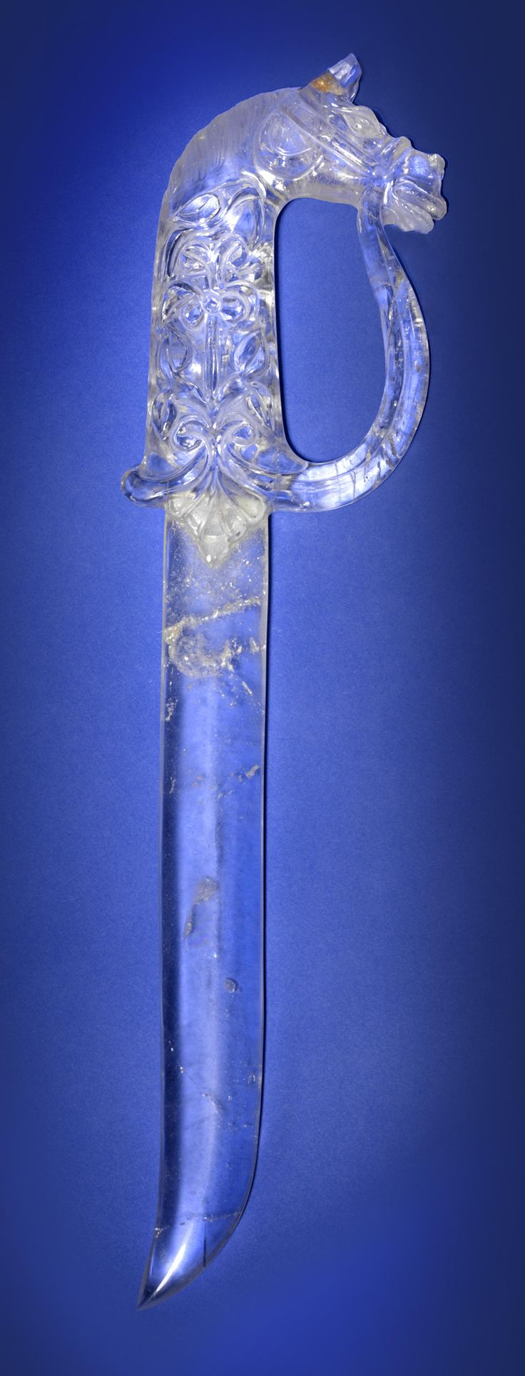 Himalayan Quartz Dagger India  Carved of quartz from the Himalayan Mountains, decorated with a horse's head and other Mughal themed motifs. Length 14 in.