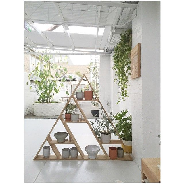 The entry to our showroom... Cenzo design Triangle shelf, Anchor ceramics and Pono wall hanging. Everything in our showroom is made by the residents here at Pop & Scott and you will be able to purchase through us. #open30thofmay @alzee75 build our beautiful big round brick planters.