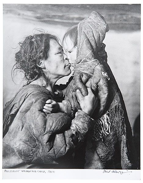 Padleimuit woman and her child inside their igloo in the Canadian Arctic, 1950, by Richard Harrington