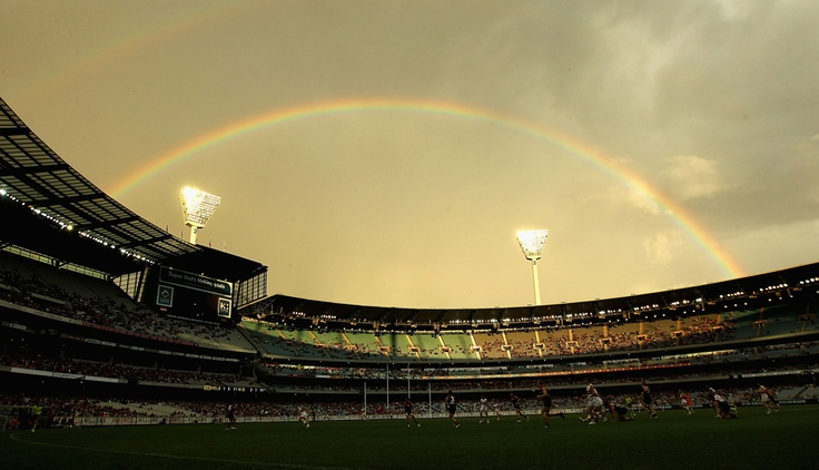 AFL play takes place under a rainbow during the Jim Stynes Tribute match between Melbourne and Western Bulldogs at Melbourne Cricket Ground on April 22, 2012.