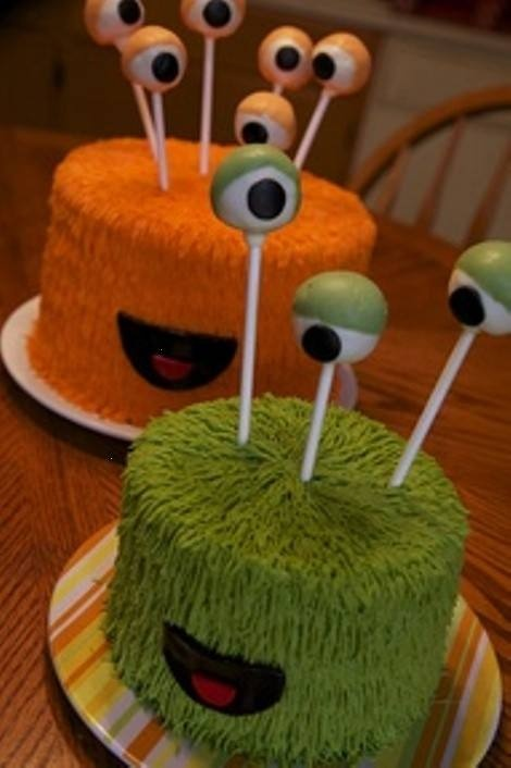 "Fun monster cakes...First birthday option could be to utilize the actual cake as a ""smash cake"" and make cake pop ""eyeballs"" for the guests!"