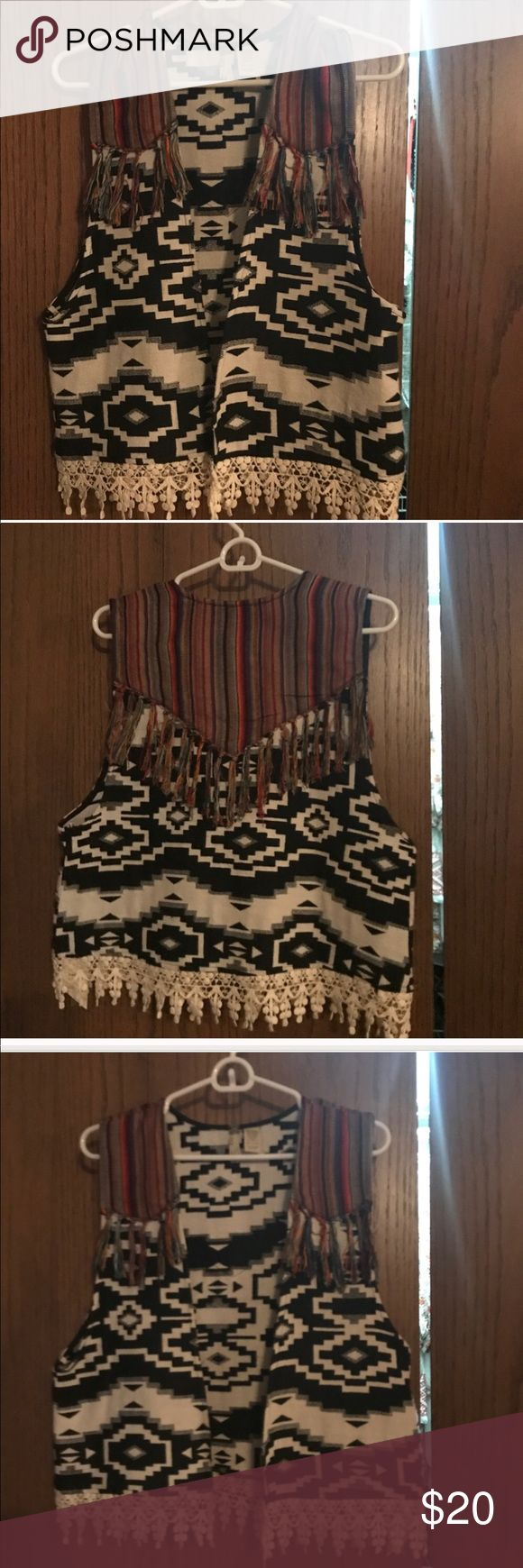 Gimmicks NEVER WORN Aztec vest! Gimmicks NEVER WORN Aztec vest! So beautiful. Just didn't fit my bust. Size Large. No tags but new condition. gimmicks Tops Blouses