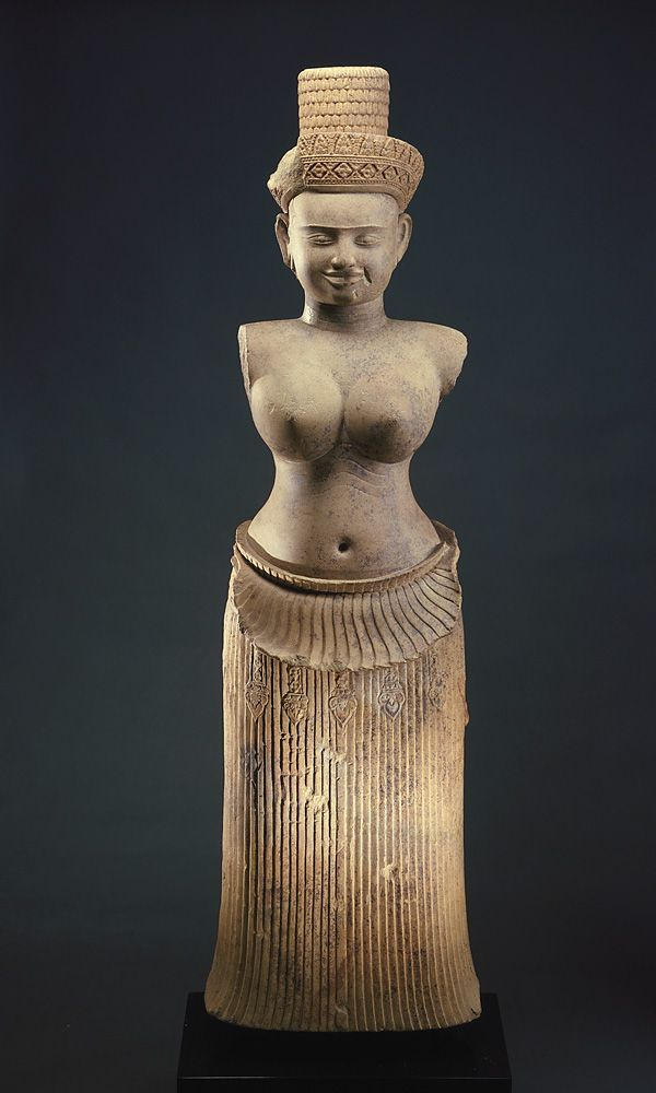 ~The Goddess Uma. Date: 10th century Period: Angkor period Medium: Sandstone Place of origin: Koh Ker, Cambodia From the source: This hierarchic majestic figure wears a precisely pleated skirt whose downturned upper edge creates a prominent fold over...