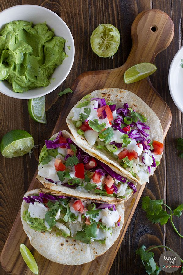Craving these!!! Just like LaJolla ... A healthier fish taco, this Baja Fish Taco Recipe has grilled flaky white fish, a creamy avocado sauce, and a tangy white mayo sauce.