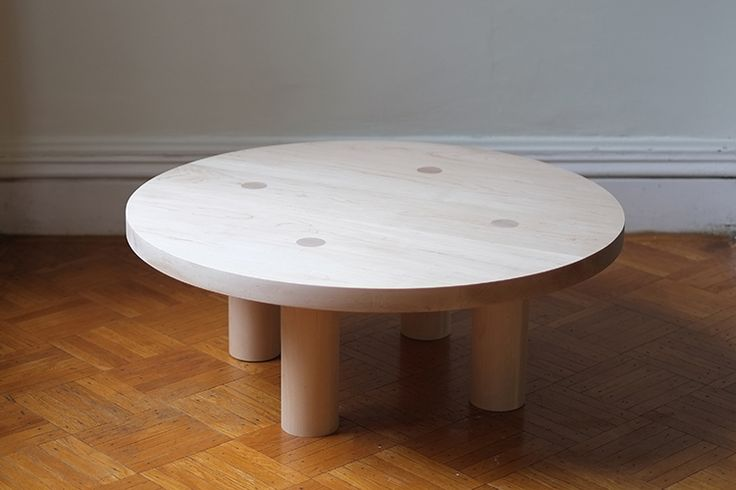 """Coffee table. Maple or walnut. 36""""dia x 14""""h. Family room."""