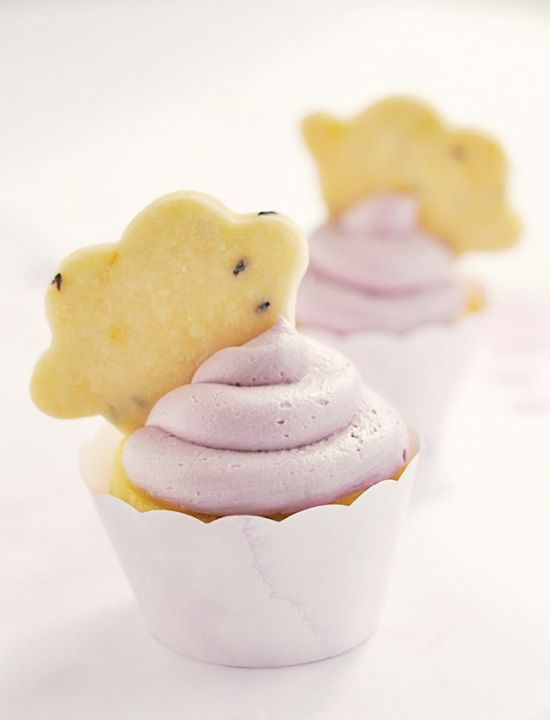 La La Lavender & Lemon Cloud Cupcakes. Light, citrusy lemon buttermilk cupcakes, topped with tangy homemade lemon curd with whipped lavender frosting. #cupcake #recipe