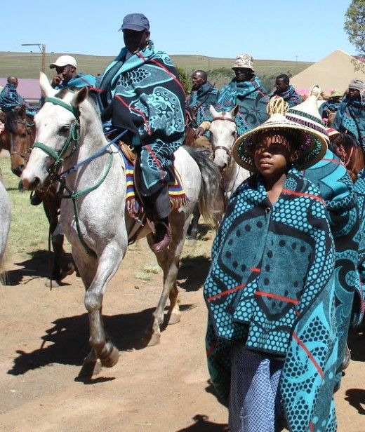 Basotho in the Parade of the blankets and men riding their horses