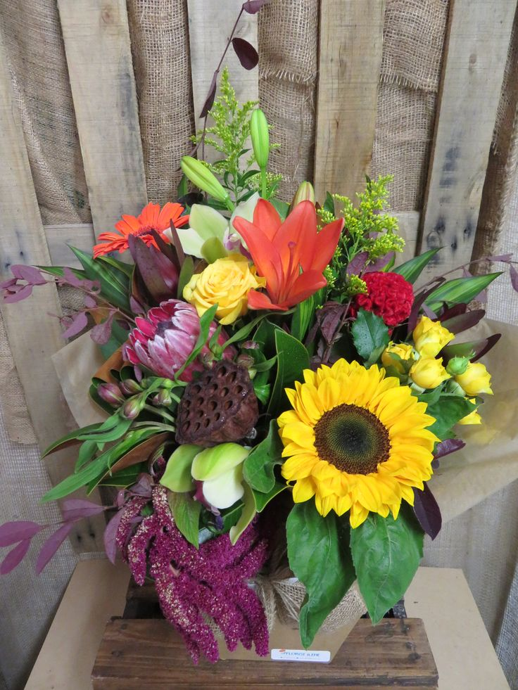 Stunning bouquet created here at Florist ilene. Such a nice mix of colours and flowers.