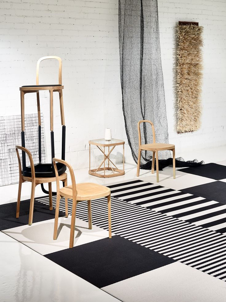 Woodnotes Squareplay, Big Stripe and Stripe paper yarn carpets, Siro+ oak chairs, Twiggy oak table and Veil hand knitted curtain. Natural. Wooden. Simplicity.