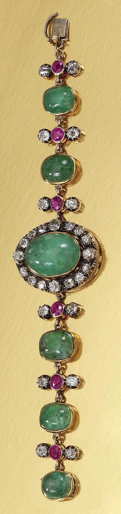 MERALD, RUBY AND DIAMOND BRACELET, LATE 19TH CENTURY.  The central plaque set with an oval cabochon emerald within a surround of circular-cut diamonds, to links collet-set with cabochon emeralds alternating with circular-cut rubies and diamonds, engraved to the reverse with Chinese characters for 'Health', 'Longevity', 'Peace' and 'Prosperity', length approximately 175mm.