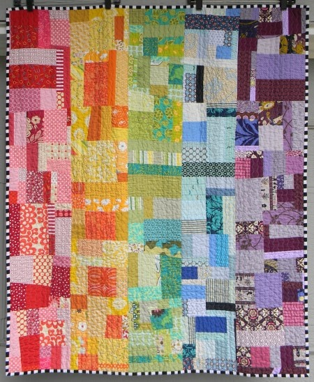 Love these rainbow scrap quilts.
