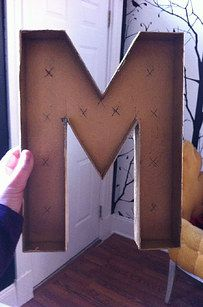 Show off your new last initial with your very own light-up marquee letter: | 24 DIY Decorations That Will Make Any Wedding Look Like A Million Bucks
