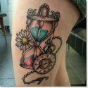 pocket watch tattoo on thigh
