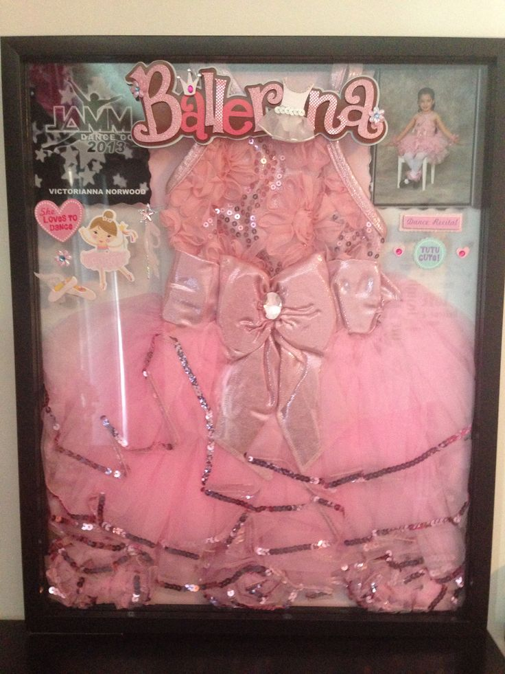 Her first dance recital costume and picture with embellishments. I put those on the outside of the frame/shadow box. Gives it dimension.
