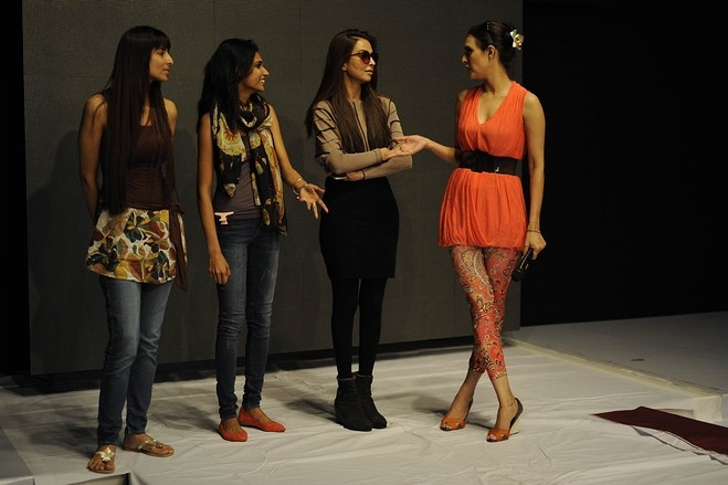 Models took a break during rehearsals on the second day of Fashion Pakistan Week, Karachi, April, 2013