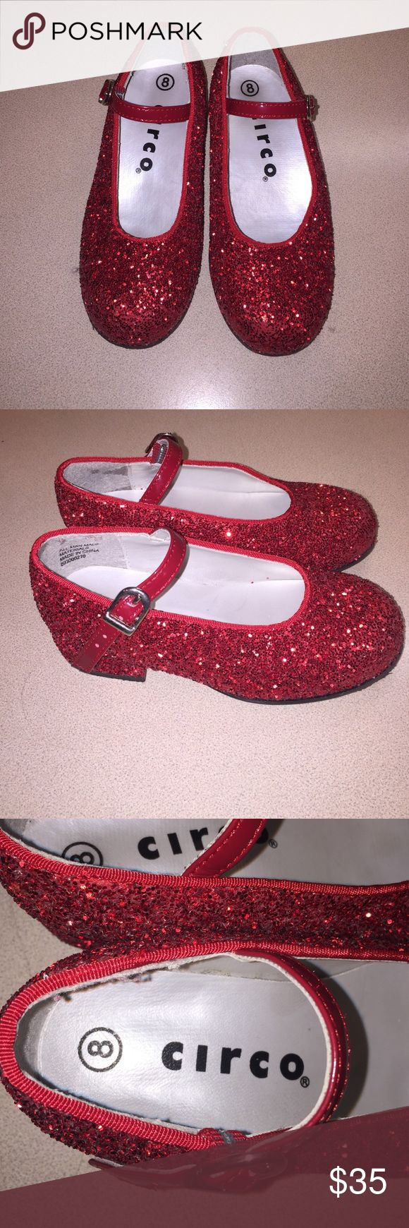 Dorothy inspired dress shoes. These kids shoes are perfect for a fancy dinner out or even a Dorothy inspired Halloween costume. They are super sparkly and have an adjustable tie. Slightly heeled on the bottom. Worn once. Circo Shoes Dress Shoes