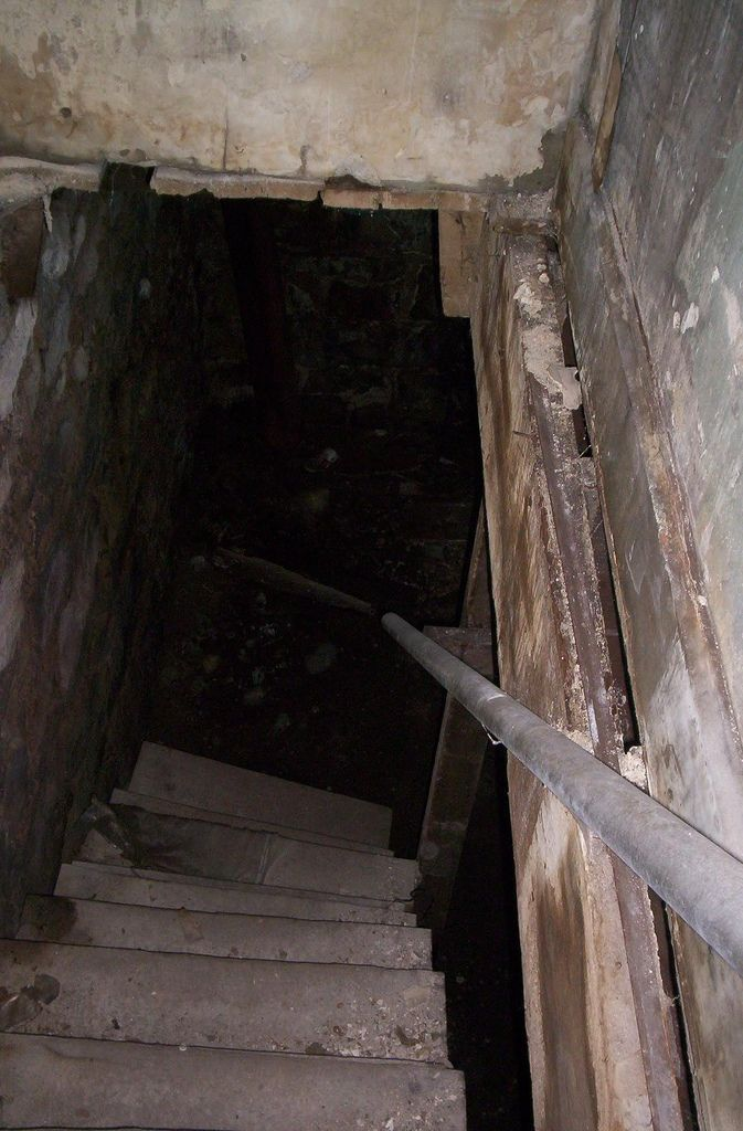 creepy basement of abandoned nite club in st louis steven a