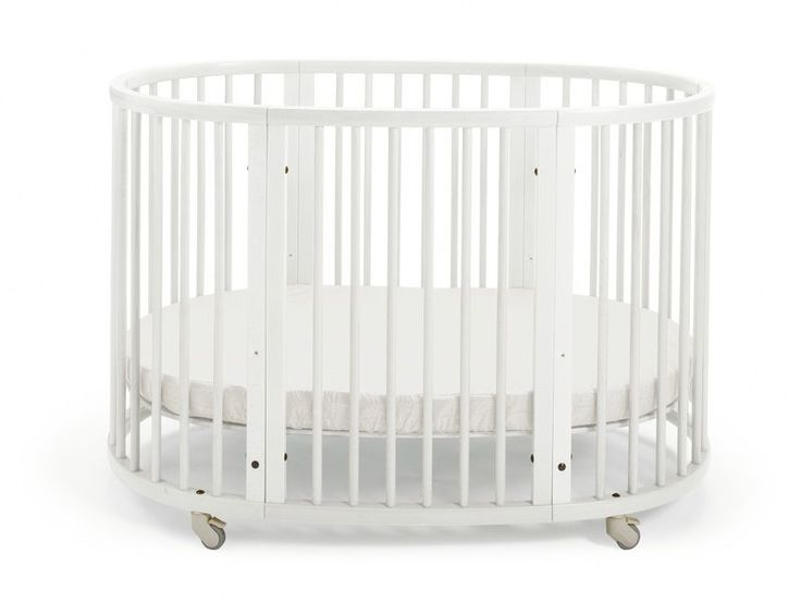 Beautiful Oval Shaped Modern Stokke® Sleepi™ Crib/Bed in white – Has an adjustable height mattress & convertible design that grows w/ baby too
