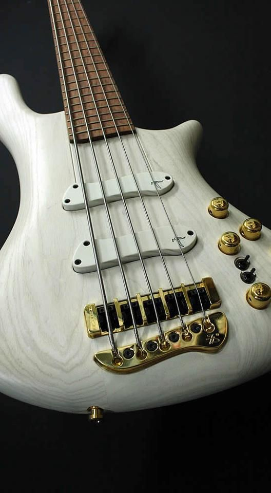 White on Gold Jerzy Drozd 5-String Bass Guitar.