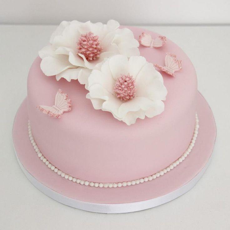 Pastel rosa flores anémonas y mariposas