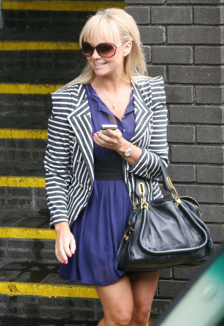 Emma Bunton purple dress black and white striped blazer black leather purse