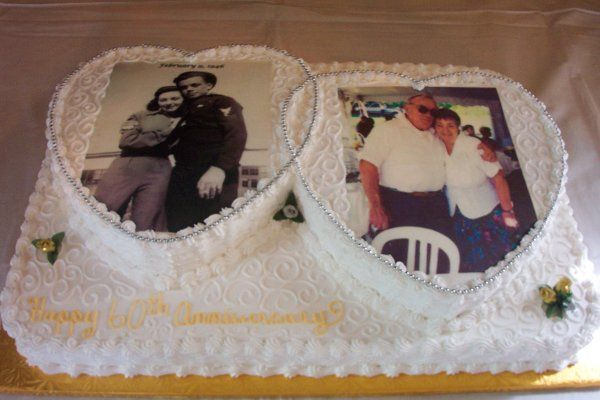 60th Anniversary cake featuring the couple's wedding picture and recent picture.