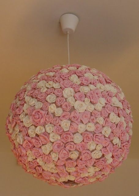 What an inventive Ikea Hack!! All you need is the Regolit lamp and some crepe paper flowers