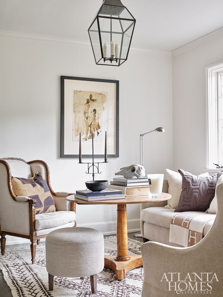 """In the cozy den just off the entry foyer, the challenge was """"to create multiple seating areas without overcrowding the space,"""" says longtime friend Eleanor Roper, who helped Debbie and Brad Weitz execute their less-is-more vision in their recently renovated home."""