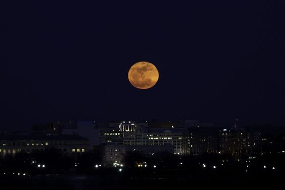"""U.S. Capitol Meet the SupermoonCredit: Sandy AdamsPhotographer Sandy Adams snapped this great view of the """"supermoon"""" full moon of March 19, 2011 over Washington, D.C."""