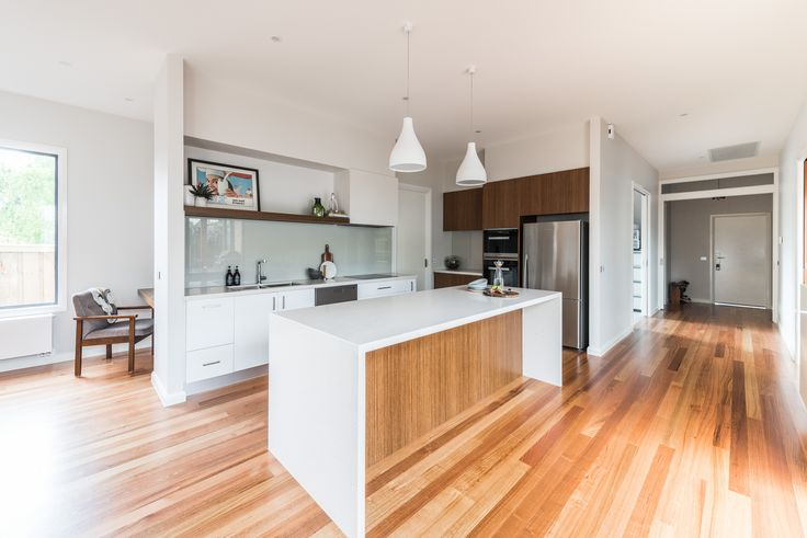 Crisp white kitchen with timber accents