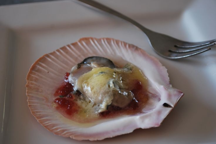 I used an oyster (the shell was broken, lol), but probably suit a scallop better....this is cranberry sauce & blue cheese on an oyster under the grill until cheese melts. delicious!