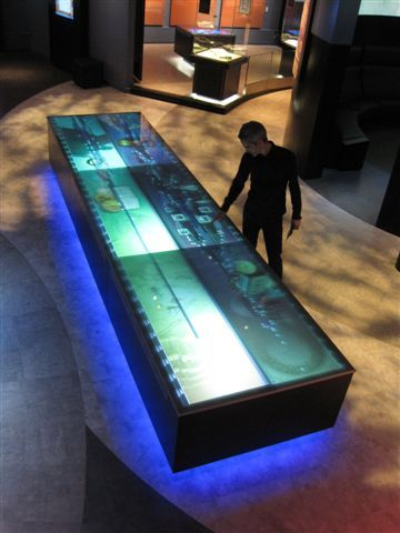 Successful: it condensed 1500 years of information into a holistic, multi touch, multi layered interface. users select objects which lead them to hidden interfaces where they can focus on a single item within the grand scheme of the whole timeline. open to individual and shared experience