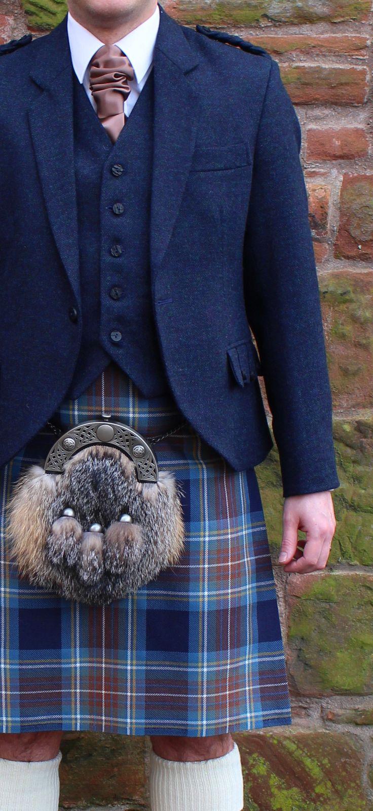 Holyrood tartan with midnight blue tweed jacket & vest and grey fox sporran