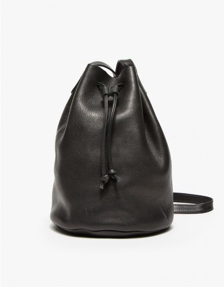 Baggu drawstring bucket bag with moderns style. Purse features a leather drawcord opening and extra long shoulder strap.