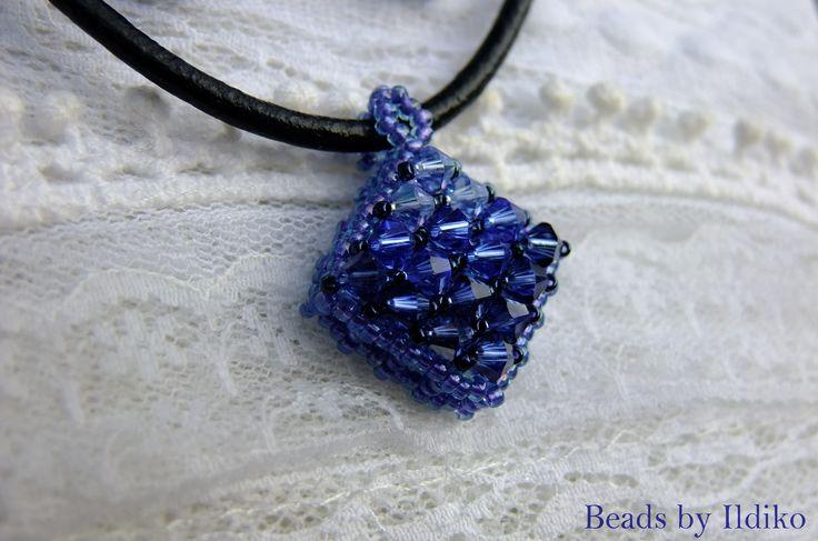 CRAW pendant with sapphire swarovski bicones