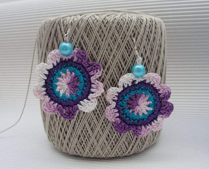 Handmade crochet flower earrings in boho style with silver hooks and glass beads