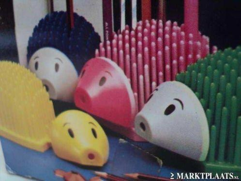 ooooh used to have the pink one when I was little! - pencil holder and sharpener