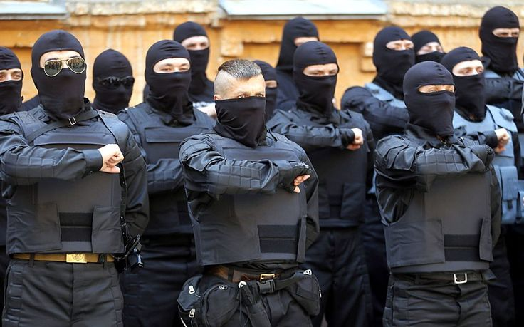 New soldiers of Ukrainian army battalion 'Azov' attend their oath of allegiance ceremony in Kiev before departing to eastern Ukraine