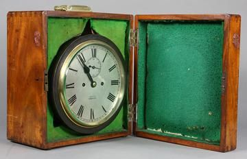 """English martime chronometer, the brass and patinated metal case, labeled """"Moses Gosport"""", housed in a hinged case, 9""""d - Price Estimate: $500 - $700"""
