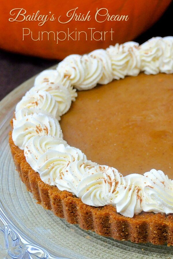 Bailey's Irish Cream Pumpkin Tart - an alternative to Thanksgiving pumpkin pie with a buttery graham crumb crust, less of the heavy filling and topped off with an Irish Cream infused whipped cream.
