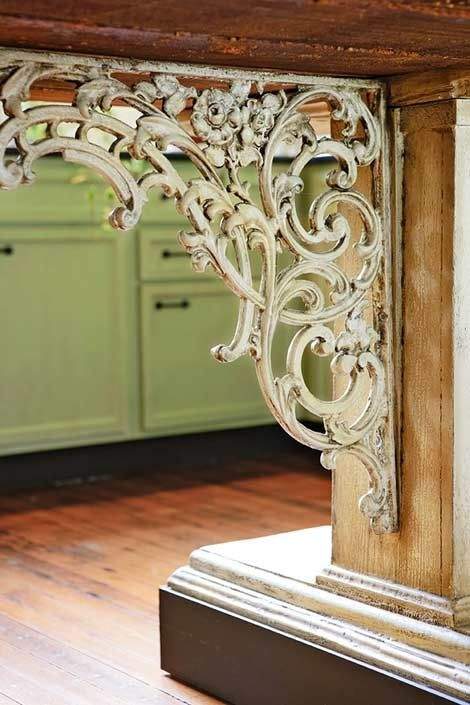 Superb Decorative iron brackets with timeworn finishes add texture and character to the kitchen
