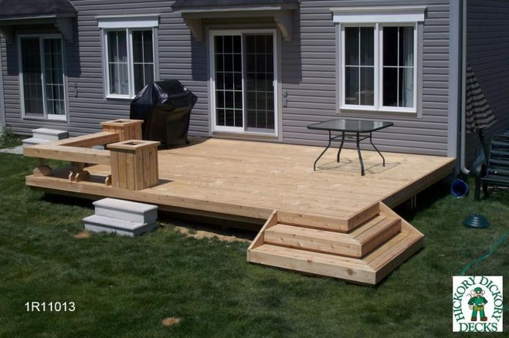 Simple low deck with a bench planters and steps home for Small deck seating ideas