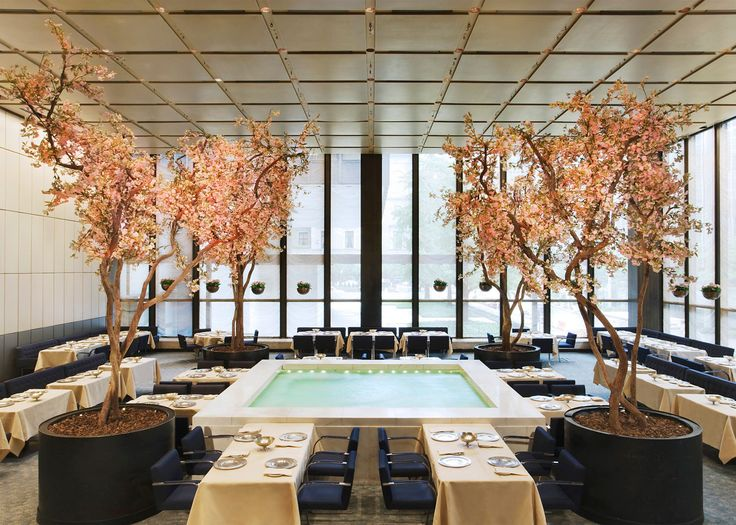 The auction of furniture and tableware from the Philip Johnson-designed The Four Seasons restaurant has brought in over four times the original estimate