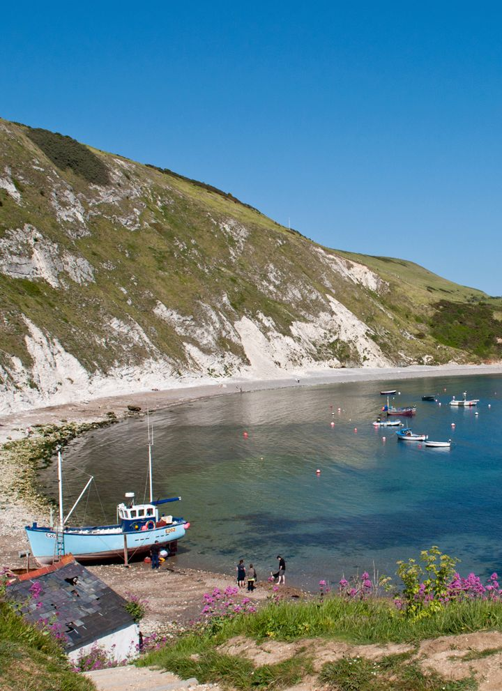 Lulworth Cove in Dorset, the perfect horseshoe-shaped cove on the Jurassic Coast, with millions of years of geological history and ancient fossils.