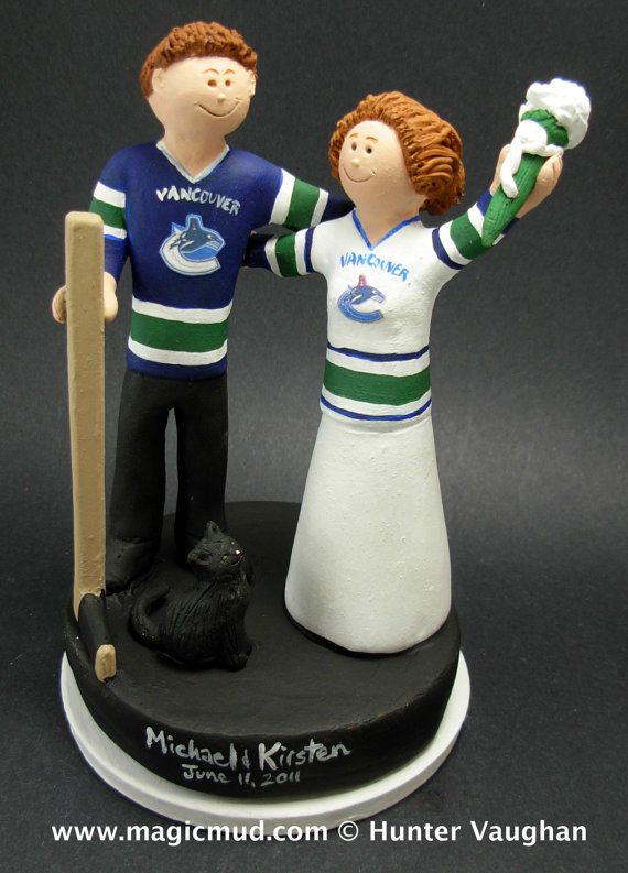Vancouver Canucks Hockey Wedding Cake Topper, Hockey Bride and Groom Wedding Anniversary Gift / Cake Topper, Stanley Cup Wedding CakeTopper    Custom created for you! Handmade to your specifications by magicmud.com of kiln fired clay. Perfect one of a kind personalized keepsake for a NHL Hockey Wedding.    $235 #magicmud 1 800 231 9814 www.magicmud.com