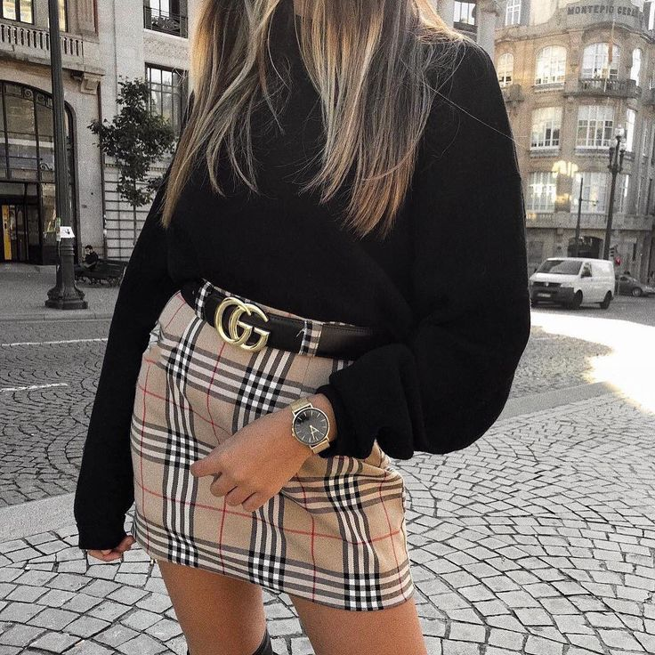 Plaid skirt and black sweater. Cute winter/fall outfit. Love the belt!