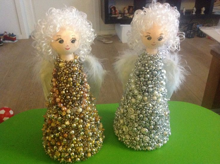 2 big Angels made with pearls and nails