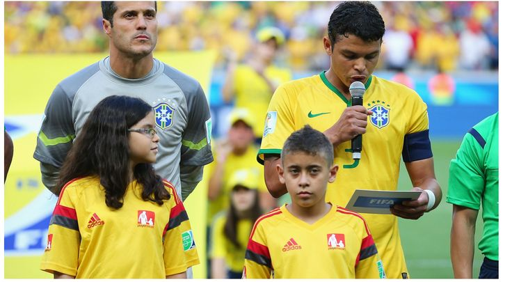 Thiago Silva (R) of Brazil reads a declaration against discrimination