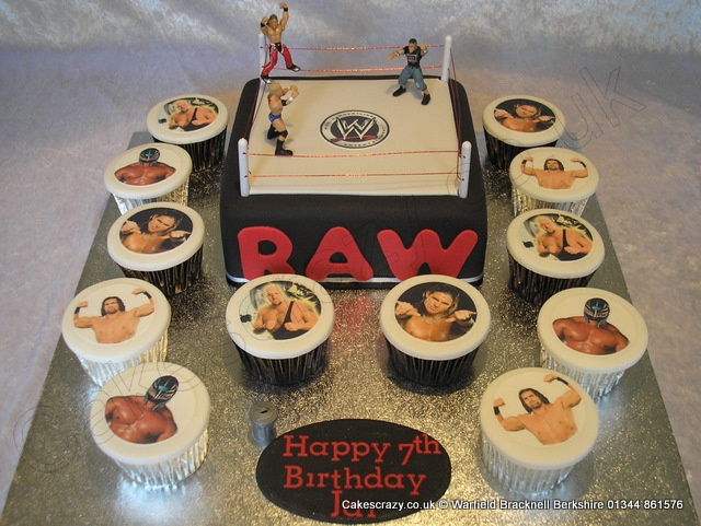 WWE Wrestling Cake. WWE themed celebration birthday cake in the shape of a WWE wrestling ring. Accompanied with a selection of WWE character photo cupcakes.   The models are non edible